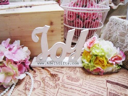 Joy wood letter
